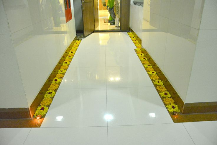 Door path decorated by petals and traditional indian diwali oil lamps