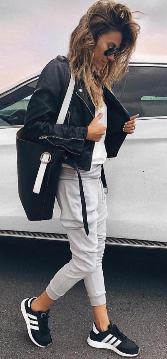 #fall #outfits  women's black motorcycle jacket, white shirt, gray jogger pants, and white-and-black Adidas Ultra Boost sneakers outfit