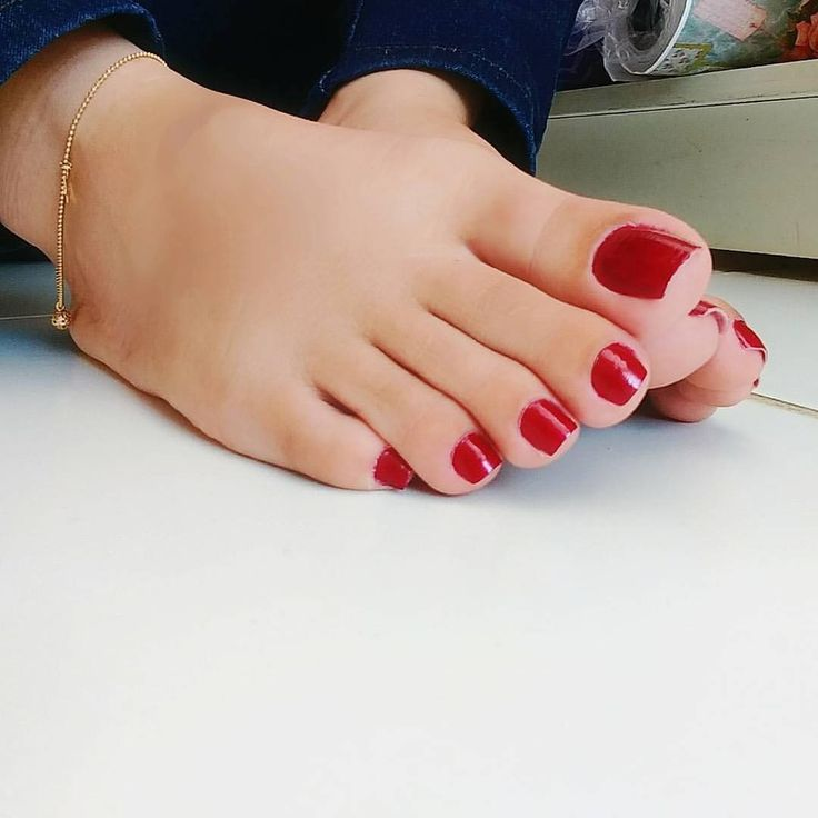 Perfect size and shaped nails for length of toes, smooth skin tone. Love red nails!