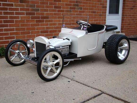 Looks like a lawnmower powered kiddie car...