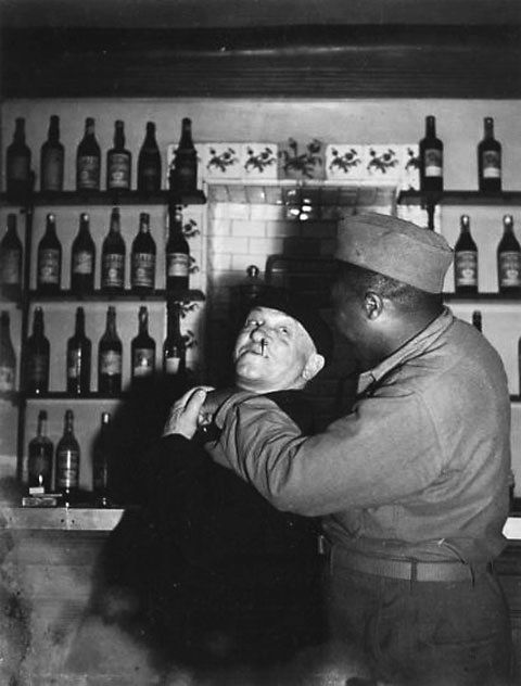 Robert Doisneau // Blaise Cendrars with a black American soldier at Cafe des Deux Garçons, Aix-en-Provence, ca. 1945. ( http://www.gettyimages.co.uk/detail/news-photo/blaise-cendrars-with-a-black-american-soldier-at-cafe-des-news-photo/121514554