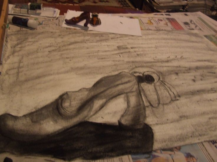 Half completed charcoal drawing using different tones.