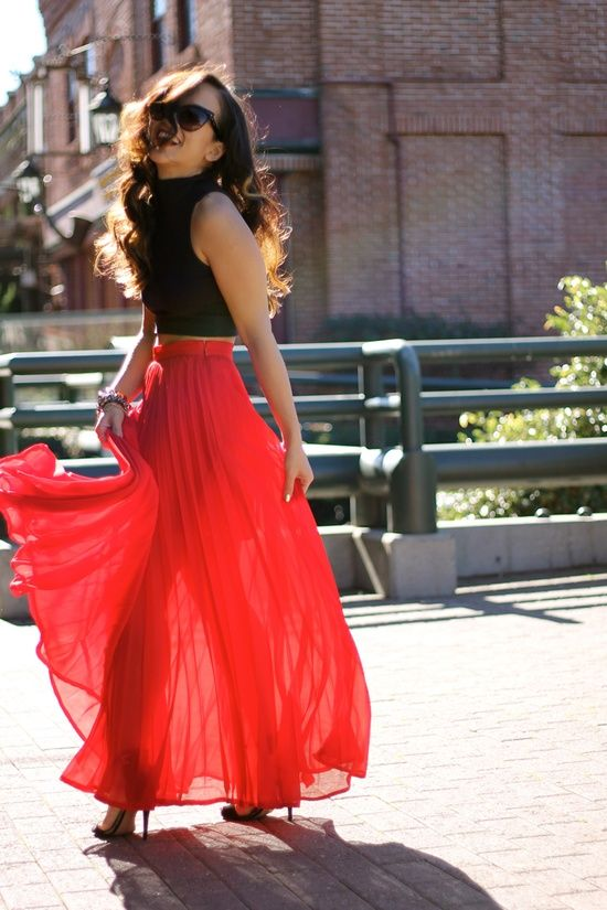 Black tank top, a red maxi skirt, and black heels.