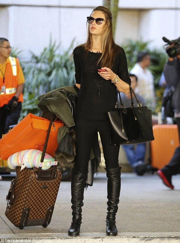 Homecoming: Alessandra Ambrosio looked chic and stylish in her all-black ensemble as she trekked home to LA from Paris in time to spend Than...