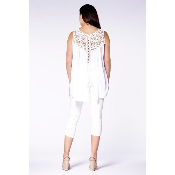 With appliqué details and crochet inserts, this top has every type of fancy...and versatile covered! Wear it front ways, or back! Whatever your heart desires.  Content: 60% Cotton, 40% Polyester  Fit: Regular