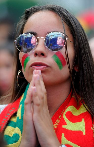 #EURO2016 A Portugal national football team's supporter prays in Porto on June 30 before the Euro 2016 football match between Portugal and Poland held at the...