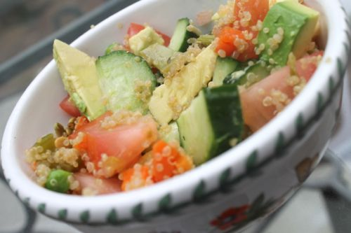 Quinoa salad with peas, carrots, and avocado with cucumber