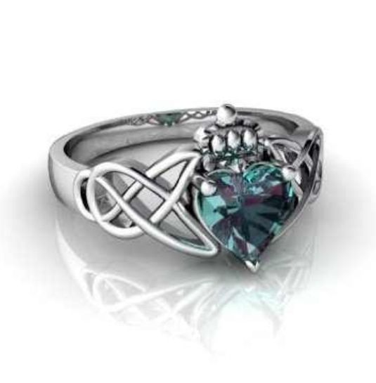 It looks like a variation of a Claddagh ring, I love it!