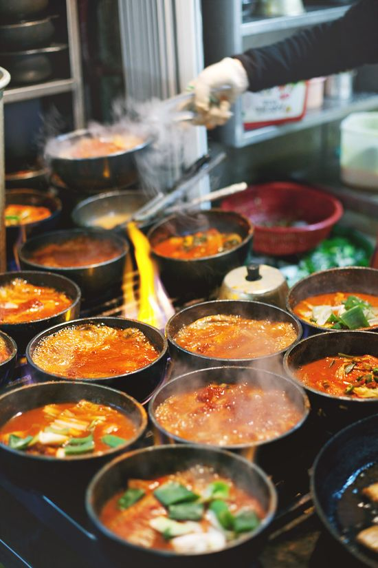bubbling stone pots of fiery jjigae (stew), Namdaemun Market, Seoul, Korea [this is by far the best food blog I've seen for his trip to Seoul.]