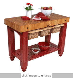 End-grain butcher block, island table - and it's got slide out cutting boards with slide out baskets! #cultivateit