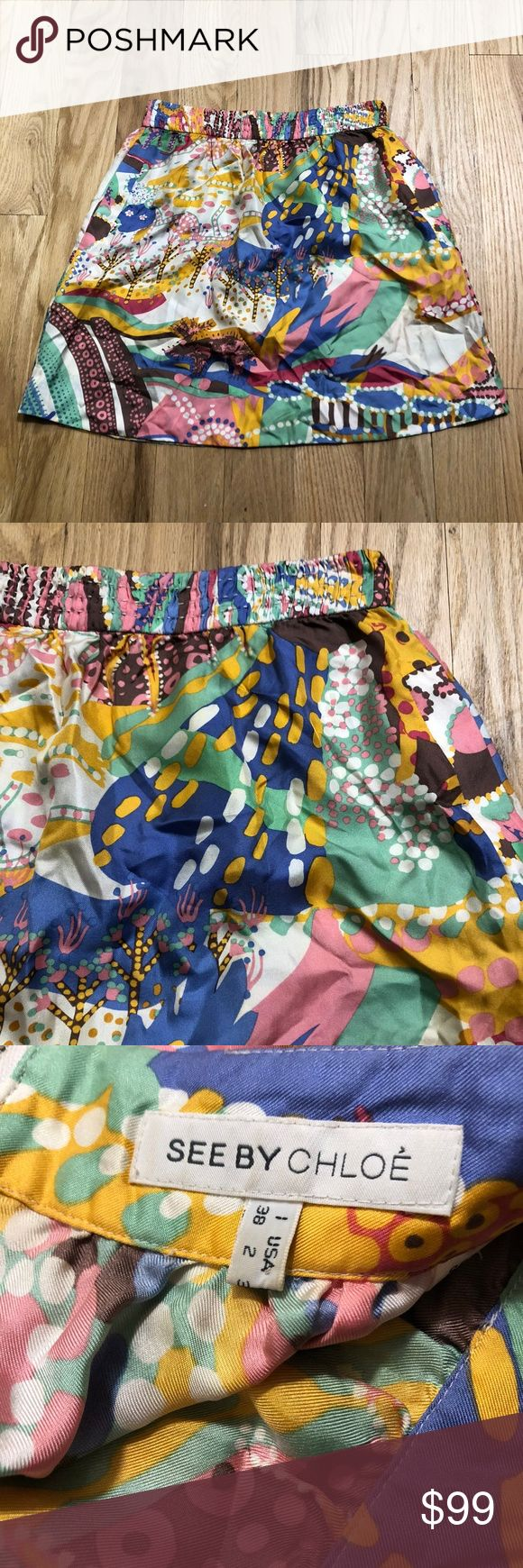 """See by Chloe Silk Abstract Mini Skirt See by Chloe mini skirt. 100% silk. Abstrat multicolor print all over. Elastic waistband. Exposed back zipper. Two hip pockets. Size 2. Approx 13.25"""" across waist, 17.5"""" long.  No signs of wear. EUC.  No trades. Reasonable offers always welcomes! See by Chloe Skirts Mini"""