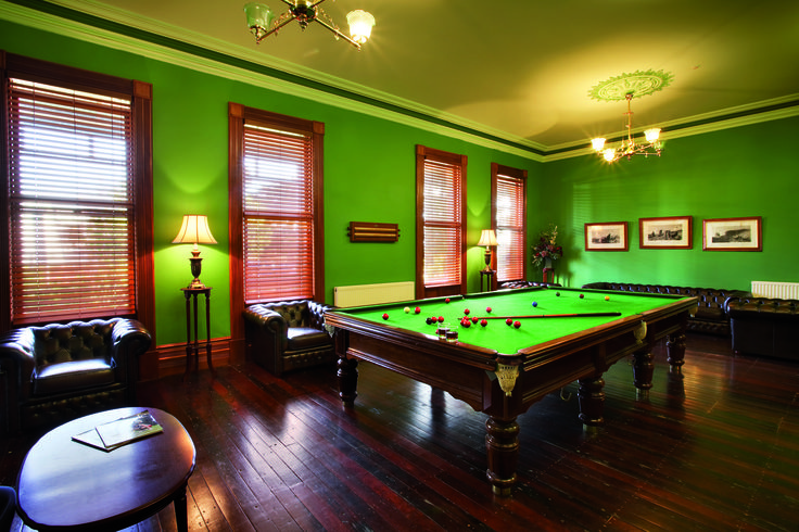 A private club room with a full size snooker table in the Homestead at Cleveland Winery