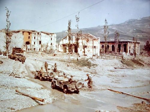 Italian Campaign, Spring 1945: vehicles of the 81st Reconnaissance Squadron of the 1st Armored Division, US Army, ford a stream on the outskirts of Vergato, a little town 42 km South Bologna, at this time situated on the Gothic Line's sector, and near completely destroyed during the Spring offensive of Allied forces in Northern Italy towards Bologna and the Po Valley. Victor Sierra