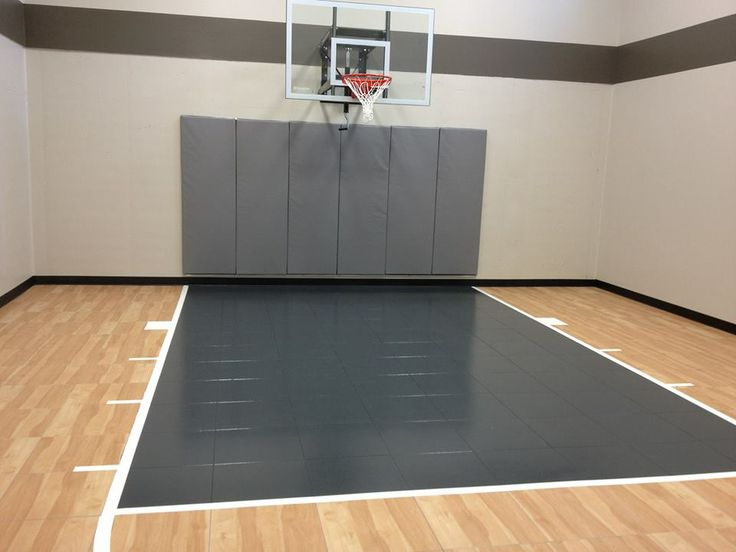 Residential family indoor home basketball court with for Indoor basketball court installation