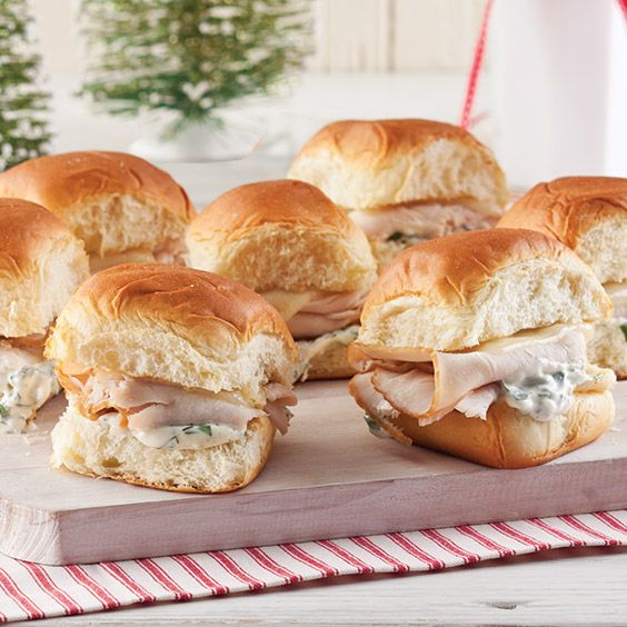TheseRanch Turkey Sliders are layered with savorymayonnaise, fresh parsley and dill, Dijon mustard, and Swiss cheese.