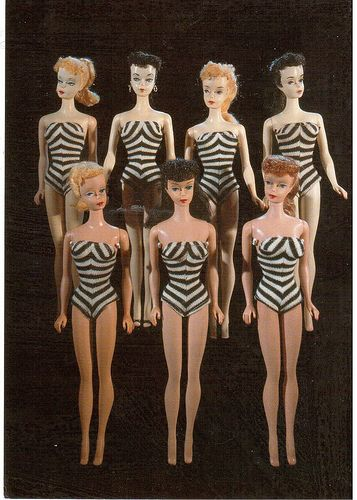 The First Barbies from the Toy Museums Munich and Prague.  Top from left to right: 1. Blonde, 1959. 2. Brunette, 1959. 3. Blonde and Brunette, 1960. 4., 5., and 6.  Ponytail Barbies, 1960-1961.  Made by Mattel, California. Card sent by Postcrosser in Russia.