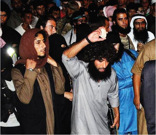 A picture of a stoning from the Islamic State's Dabiq magazine (Issue #2)