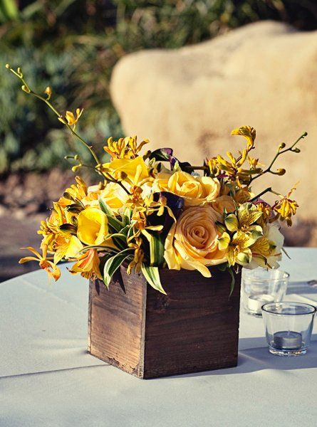love this centerpiece idea! I like that guests can still be able to see over it to talk to one another