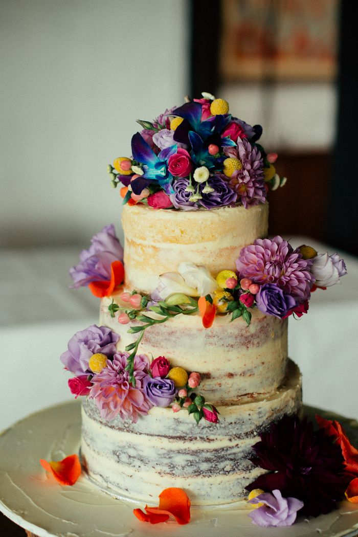 Bright floral naked cake captured by Sarah Godenzi @ Yarra Ranges Estate
