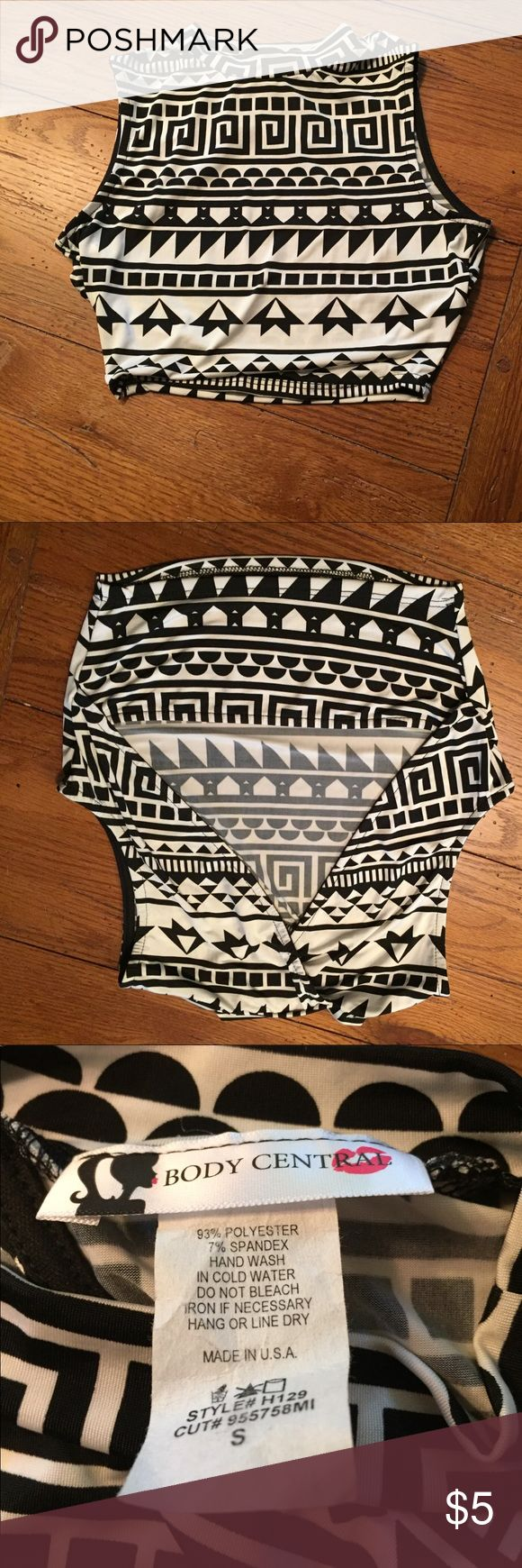 Black and white crop top Black and white crop top from Body Central. Vey soft and satiny. Polyester and spandex. Has triangle opening in back. Size small. Entire closet is BOGO half off and all tops are BOGO free! Body Central Tops Crop Tops