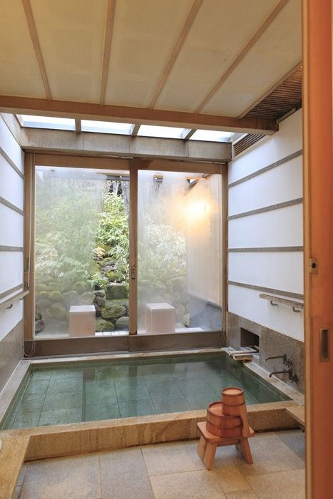 bath w. sliding door to a garden -- nice!