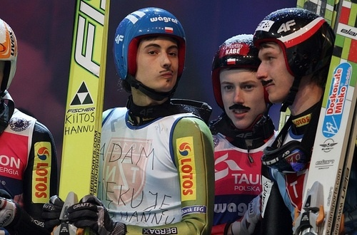 Polish skijumpers goofing off with Adam Małysz moustaches