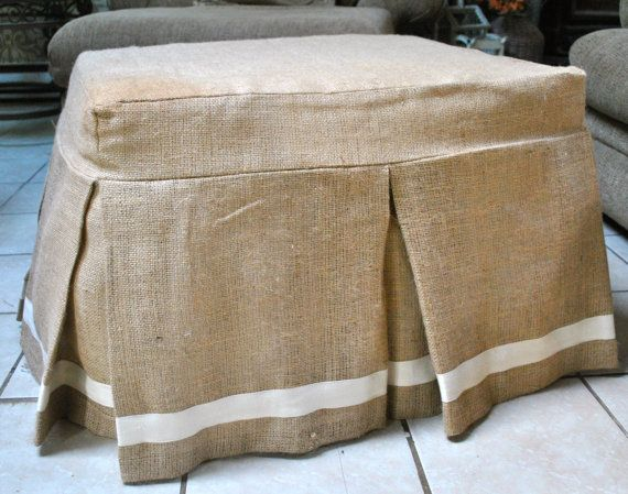 Hmmm.  What if I just put some foam on top of an old coffee table, draped some padding (even an old cut comforter?) on top, and then made a simple slipcover like this to slide over it?