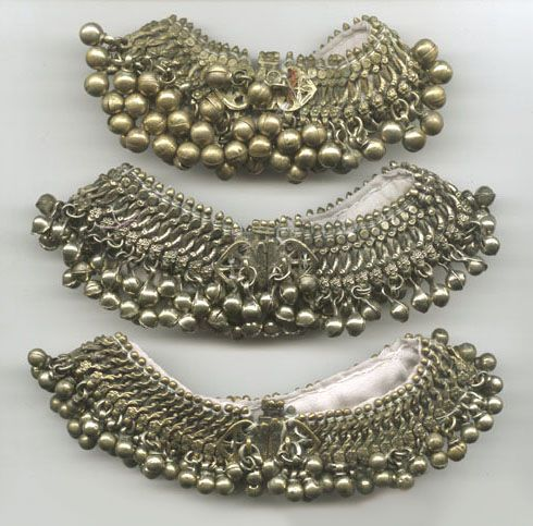 Afghanistan |  Kuchi tribal anklets with bells, sewn onto fabric backing.  These are made from mixed base metals (often called 'gillet' or 'white brass' ) and not silver.