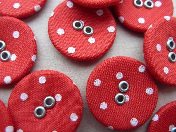 Four pink buttons circled diameter 2.2 cm