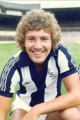 This Young Man became the longest  serving Captain of Man. Utd. He also Captained his National team (England 65 times). His Name Bryan Robson seen here in his West Brom Strip.