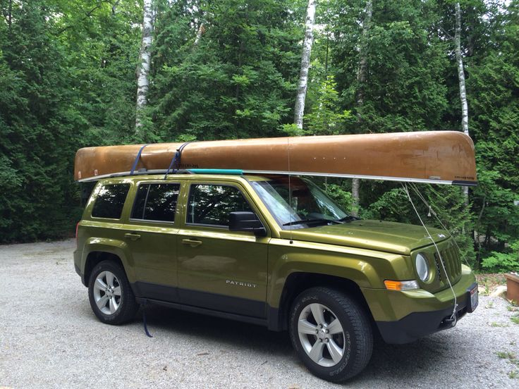 My green Jeep Patriot with my Kevlar canoe, in Door County, Wisconsin.