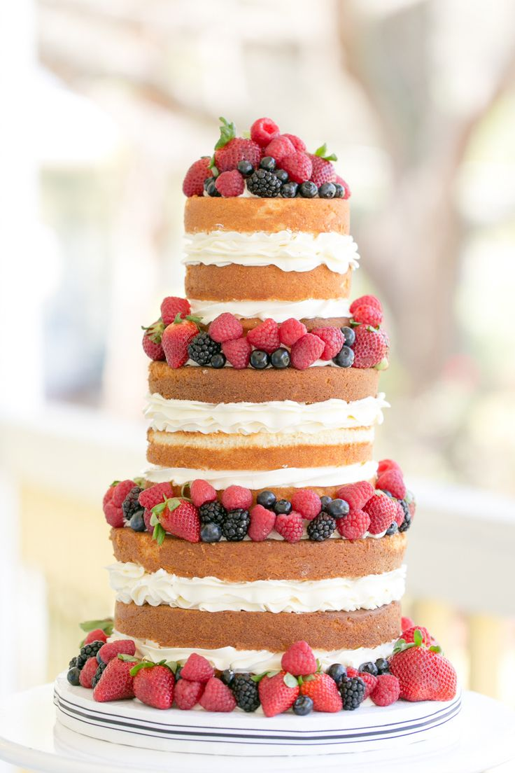 Naked Cake -- We know, we know... naked wedding cakes aren't everyone's favorite. But when the berries are so plump and the layers of frosting are as wide as the layers of cake -- this one might just change your mind ;)  Cake by TheSugarSuite.com | AmalieOrrangePhotography.com