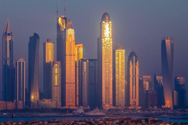 Sunset over Dubai skyline.