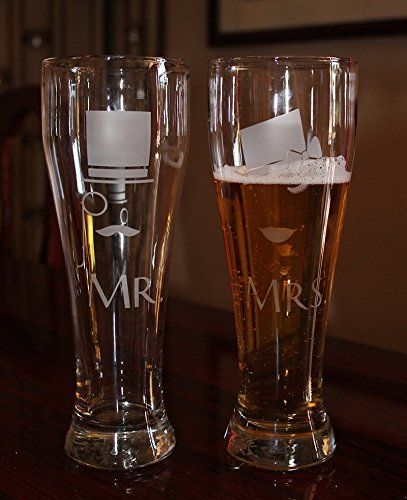 Set of 2 Mr and Mrs Victorian Hipster Hand Engraved Beer Glasses. Pour yourselves a pint of beer and toast to new beginnings with this uber cool hipster beer glass set. Absolutely Stunning for your Steampunk or Victorian wedding theme, this set of two 16 oz beer glasses will become a cherished memento of your wedding or anniversary for years to come. This glass set features a moustached Victorian gentleman decked out in top hat and monocle, and his lady, winking coyishly from under her…