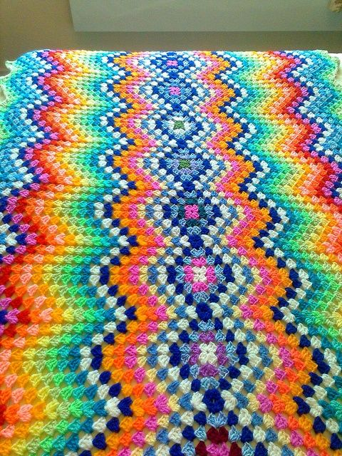 Great way to work a granny square blanket~ without a zillion granny squares. Love it!