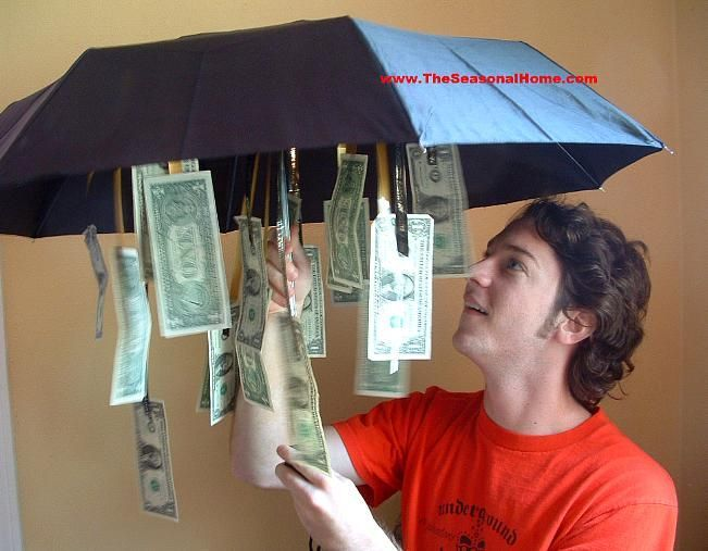 Cute gift idea......Get an inexpensive umbrella from the dollar store and dangled bills from the inside A little something for a rainy day