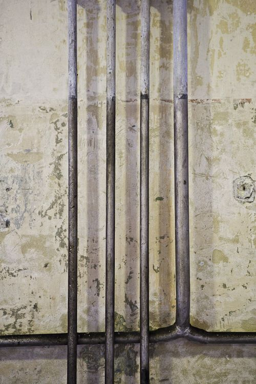 Photographic art image, minimalistic.  Pipes from concentration camp, Munich, Germany.