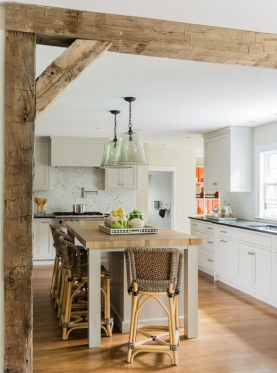 Butcher Block island, herringbone marble tile splash, glass light pendants, rough-exposed beams, white shaker cabinets... yes!