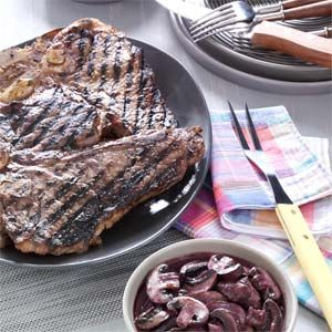 Garlic-Rubbed T-Bones with Burgundy Mushrooms Recipe from Taste of Home -- shared by Kevin Black of Cedar Rapids, Iowa