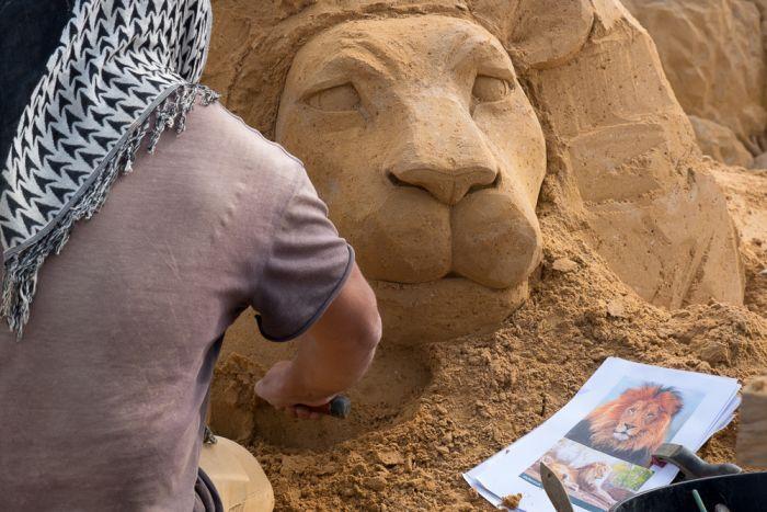 Leo Vamvalis from Melbourne creates a sand lion.