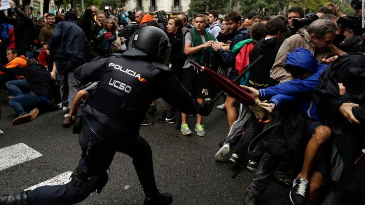 Spanish national police raided polling stations and used batons to beat back voters in an attempt to delegitimize Catalonia's independence referendum.