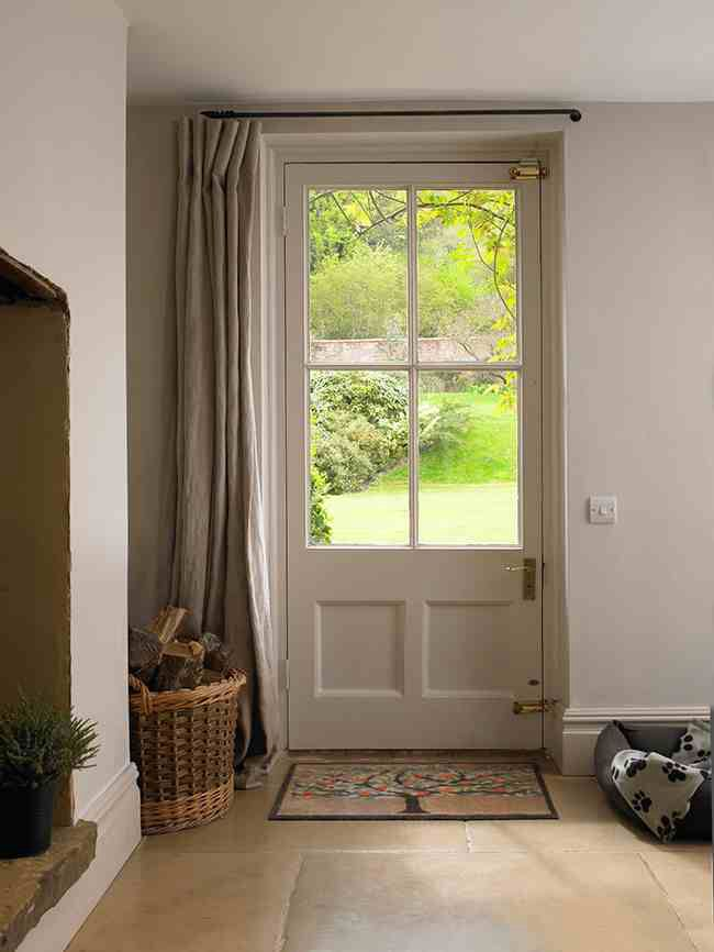 Keep your home warm with a curtain to close over door. Keep your space tidy by using wicker baskets to store logs, bits and bobs.