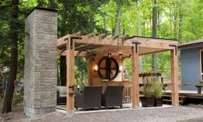 """""""Contemporary pergola with stone fireplace, comfortable seating and bar;"""""""