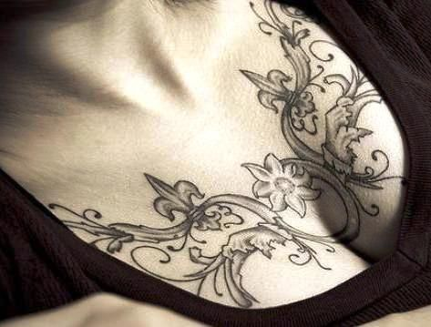 Elegant chest tattoo for tattoos and piercings for Chest tattoos for women