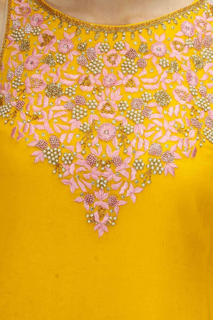 Bright yellow and pink embroidered kurta set available only at Pernia's Pop Up Shop.