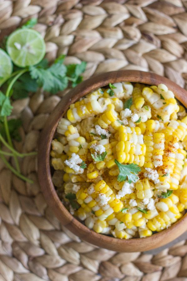 Sweet corn tossed with butter, fresh lime, chili powder, cilantro, and queso fresco. Amazing!