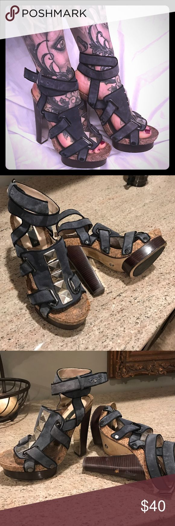 Blue suede Studded Mango heels with ankle straps These have been in my closet for years but I've been holding onto them because they're GEMS! They wrap around the ankle and button, and have a cork inset with mirror and wood platform! Worn under 5 times! Mango Shoes Heels