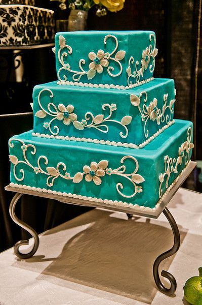 turquoise is gorgeous ... I love the design work on the sides!