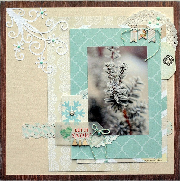 gorgeous layout of a frosty tree... love the swirling die-cut on the upper left corner and the vellum tag that doesn't overwhelm the muted colors of the photo.