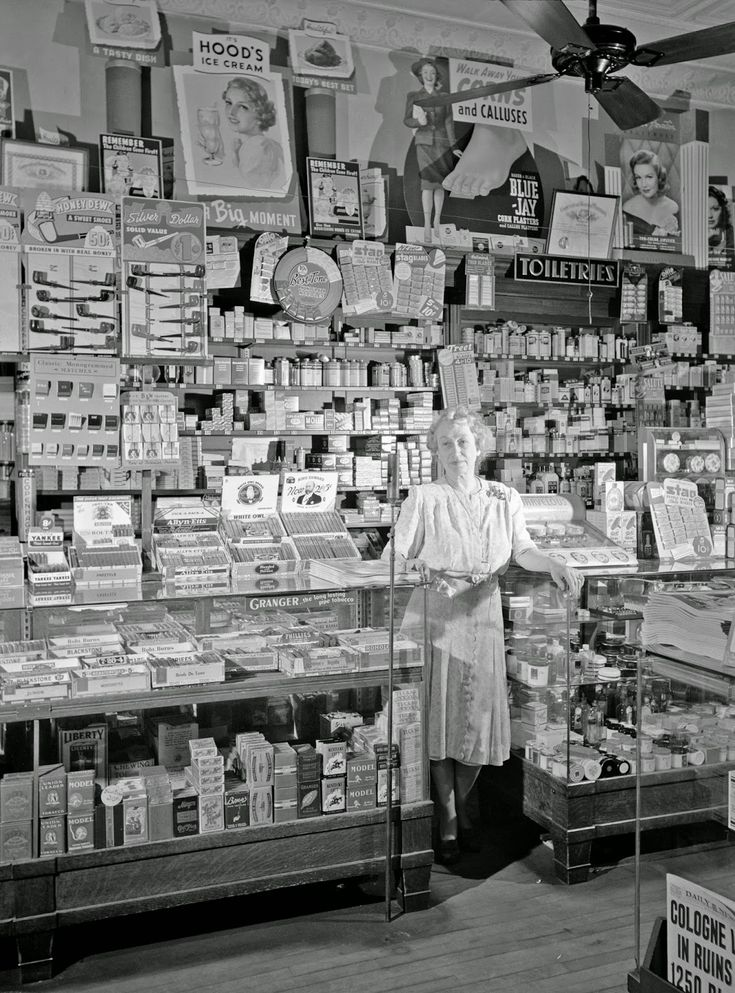 mrs. ethel oxley, in the drugstore which she runs on southington, connecticut's main street | may 1942 | #vintage #1940s #connecticut